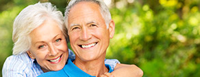 Older couple smiling brightly